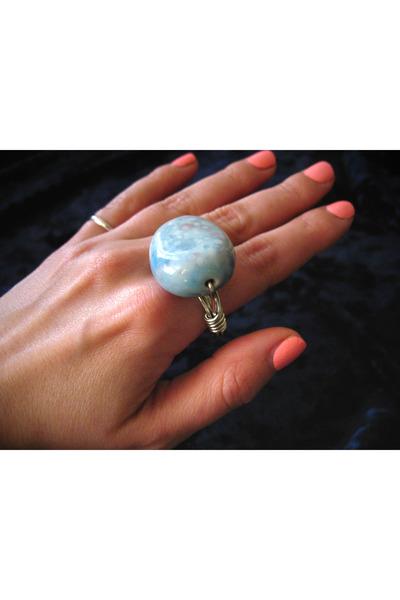 light blue CB Designs ring